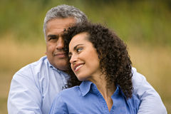 Loving hispanic couple. Attractive hispanic couple outdoors natural lighting Stock Photo
