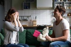 Loving husband closing eyes of wife presenting romantic surprise stock photos