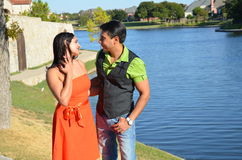 Loving Indian Couple. Attractive married Indian couple walking along a river Stock Images