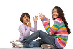 Loving indian sisters. Two indian girls sitting and playing clapping hands Royalty Free Stock Photography