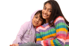 Loving indian sisters. Beautiful happy sisters over white background Stock Photos