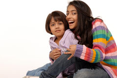 Loving indian sisters. Joyful indian sisters over white background Stock Photography