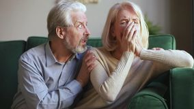 Loving kind senior husband consoling sad crying middle aged wife stock footage