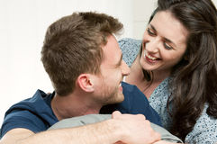 Loving laughing couple Stock Photos