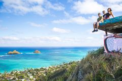 A group of friends sitting on pillbox over looking Lanikai in Ka. Loving life on the top of the Pacific Islands  group of friends sitting on pillbox over looking Stock Image
