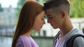 Loving male female teenagers touching foreheads, romantic feelings, tenderness. Stock footage stock footage