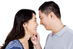Loving man adoring happy woman. Loving men adoring happy women against white background Royalty Free Stock Photos