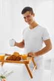 Loving man with breakfast Stock Photo
