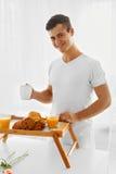 Loving man with breakfast Stock Photo
