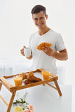 Loving man with breakfast Royalty Free Stock Photo