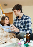 Loving man caring for sick girlfriend Stock Photos
