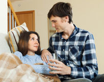 Loving man caring for sick girlfriend Royalty Free Stock Image