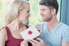 Loving man giving his wife a gift Stock Photography