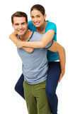 Loving Man Giving Piggyback Ride To Woman Stock Photography