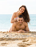 Loving man and his girlfriend  on sand beach. Loving men and his girlfriend  on sand beach at vacation Stock Photography
