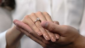 Loving man holding girlfriends hand with engagement ring on finger, marriage. Stock footage stock video