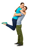 Loving Man Lifting Woman Against White Background Royalty Free Stock Photo