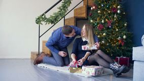 Loving man surprising his woman with christmas gift stock video footage
