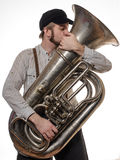 Loving man with suspenders and cap tube kisses. Beard loving man with suspenders and cap tube kisses stock photo