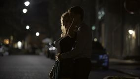 Loving man and woman dancing in night street and enjoying perfect date, romance. Stock footage stock footage