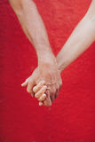 Loving man and woman holding hands Stock Photography