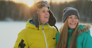 Loving man and woman skiing in the winter forest doing outdoor activities leading a healthy lifestyle. slow motion stock footage