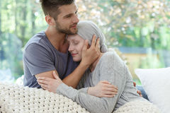 Marriage fighting with cancer together. Loving marriage fighting with her pancreatic cancer together Royalty Free Stock Photo