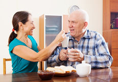 Loving mature couple having tea with jam Royalty Free Stock Photo