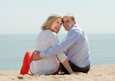Loving mature couple at sand beach Royalty Free Stock Photo