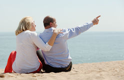 Loving mature couple at sea Stock Images