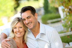 Loving mature couple sitting at home garden Royalty Free Stock Images