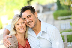 Loving mature couple sitting outdoors Royalty Free Stock Image