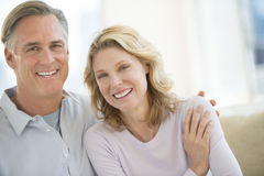 Loving Mature Couple Smiling At Home Stock Photos