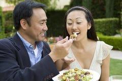 Loving Mature Man Feeding Woman Stock Photography