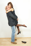 Loving me. A young man lifts his cute girlfriend. They are in love and very happy Stock Photography