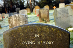 In Loving Memory. Close up on grave headstone wording In Loving Memory,shallow DOF Royalty Free Stock Images