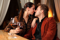 Loving man and woman in restaurant Stock Photography