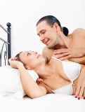 Loving middle-aged couple awaking together Royalty Free Stock Image