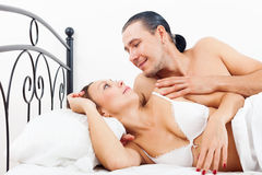 Loving middle-aged couple awaking together Stock Photography