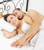 Loving middle-aged couple awaking together Royalty Free Stock Photo
