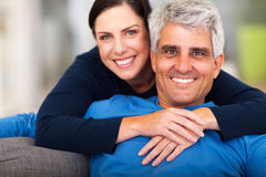 Loving middle aged couple. Happy loving middle aged couple relaxing at home Royalty Free Stock Photography