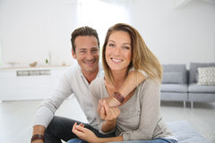 Loving middle-aged couple at home stock photos