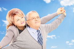 Loving middle aged couple posing outside Royalty Free Stock Images