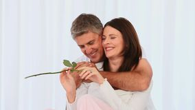 Loving middle aged couple with a rose