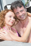 Loving middle aged couple spending romantic time by pool Royalty Free Stock Photo