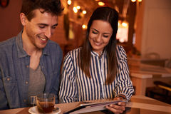 Loving millenial couple looking at tablet Stock Photo
