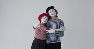 Loving mime artist couple embracing