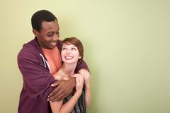 Loving mixed couple look to each other Stock Photo