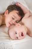 Loving Mixed Race Chinese and Caucasian Baby Brothers Embracing Stock Photo