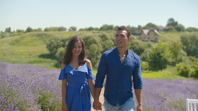 Mixed race couple enjoying a walk in floral glade